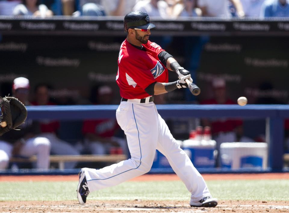 Toronto Blue Jays' Jose Bautista swings at a ball from Philadelphia Phillies starting pitcher Kyle Kendrick during the third inning of a baseball game, Friday, July 1, 2011, in Toronto. (AP Photo/The Canadian Press, Chris Young)