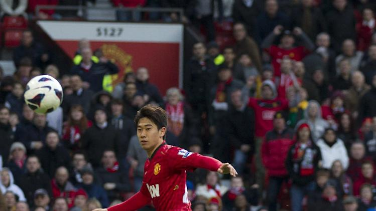 Manchester United's Shinji Kagawa, centre, scores his third goal past Norwich's goalkeeper Mark Bunn during their English Premier League soccer match at Old Trafford Stadium, Manchester, England, Saturday March 2, 2013. (AP Photo/Jon Super)