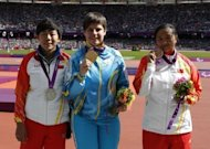 Discus athletes Ukraine's Mariia Pomazan (C) poses with China's Wu Qing (L) and China's Bao Jiongyu (R) during the London 2012 Paralympic Games. Organisers admitted that the first field event gold medallist -- Pomazan -- was wrongly awarded the F35/36 discus title
