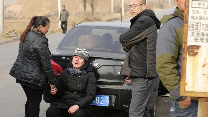 A woman cries after a coal mine fire accident at a hospital of Fu Mining Group Company in Fuxin