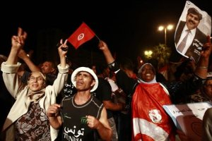 Protesters demonstrate to call for the departure of the Islamist-led ruling coalition in Tunis