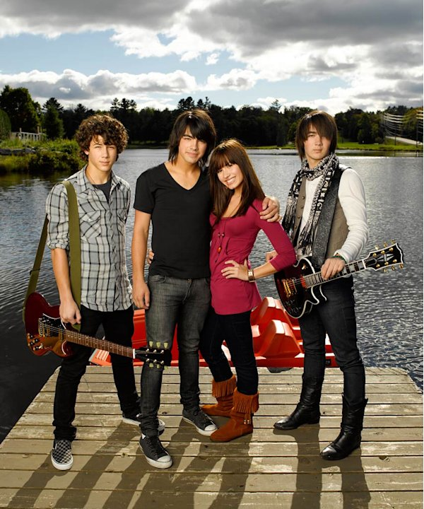 "Kevin Jonas as ""Jason,"" Demi Lovato as ""Mitchie Torres,"" Joe Jonas as ""Shane Gray,"" and Nick Jonas as ""Nate"" star in Camp Rock."