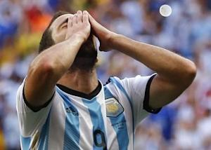 Argentina's Gonzalo Higuain reacts after missing the goal during the 2014 World Cup quarter-finals between Argentina and Belgium at the Brasilia national stadium