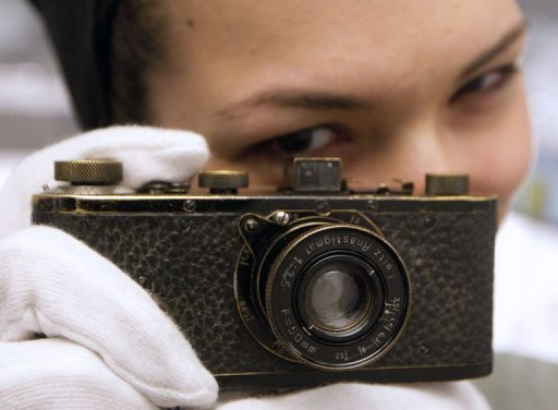 Olivia Coeln, daughter of the owner of the Westlicht Gallery Peter Coeln poses with a Leica O series