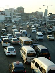 <p>Vehicles on a road in Harare. After Zimbabwe trashed its worthless local currency and allowed trade in foreign currency like US dollars, the economy started picking up.</p>