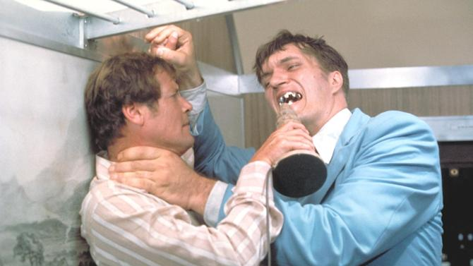 "This undated publicity photo provided by United Artists and Danjaq, LLC shows Richard Kiel, right, as Jaws and Roger Moore, as James Bond, fighting in the 1977 film, ""The Spy Who Loved Me."" Those teeth could do some serious damage. The film is included in the MGM and 20th Century Fox Home Entertainment Blu-Ray ""Bond 50"" anniversary set.  (AP Photo/United Artists and Danjaq, LLC)"