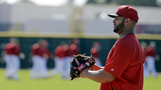 Los Angeles Angels' Albert Pujols waits for a throw during a spring training baseball workout Tuesday, March 3, 2015, in Tempe, Ariz. (AP Photo/Morry Gash)