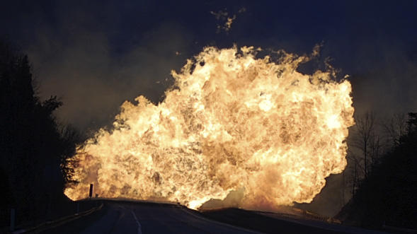 Flames fill the sky from a gas line explosion across Interstate 77 near Sissonville, W.Va., Tuesday, Dec. 11, 2012. West Virginia State Police say several structures are on fire and about a mile of Interstate 77 is shut down in both directions.  (AP Photo/Joe Long)