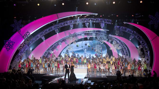 Contestants from 89 countries stand on the stage behind hosts Andy Cohen and Giuliana Rancic at the start of the Miss Universe pageant, Wednesday, Dec. 19, 2012, in Las Vegas. (AP Photo/Julie Jacobson)