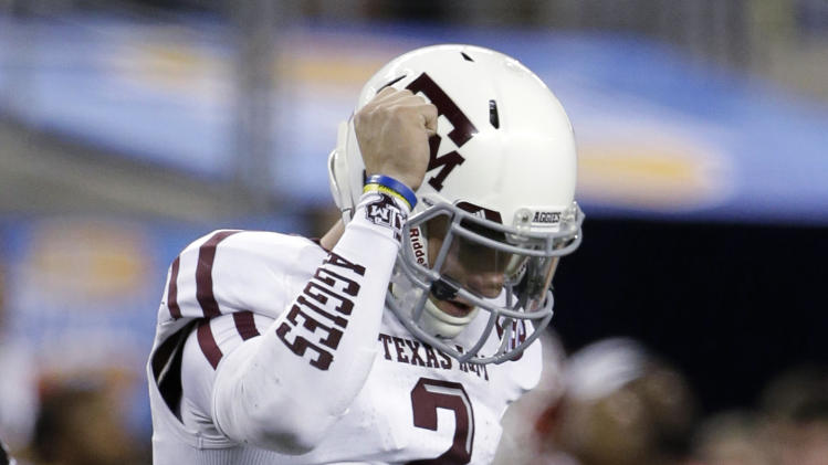 Texas A&M's Johnny Manziel celebrates a touchdown by Ben Malena in the second half of the Cotton Bowl NCAA college football game against Oklahoma on Friday, Jan. 4, 2013, in Arlington, Texas. (AP Photo/Tony Gutierrez)