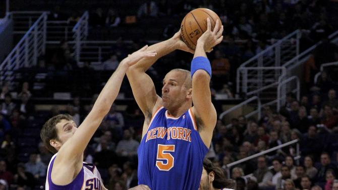 New York Knicks guard Jason Kidd (5) passes over Phoenix Suns' Goran Dragic, of Slovenia, (1), and Luis Scola, of Argentina, during the first half of an NBA basketball game on Wednesday, Dec. 26, 2012, in Phoenix. (AP Photo/Matt York)