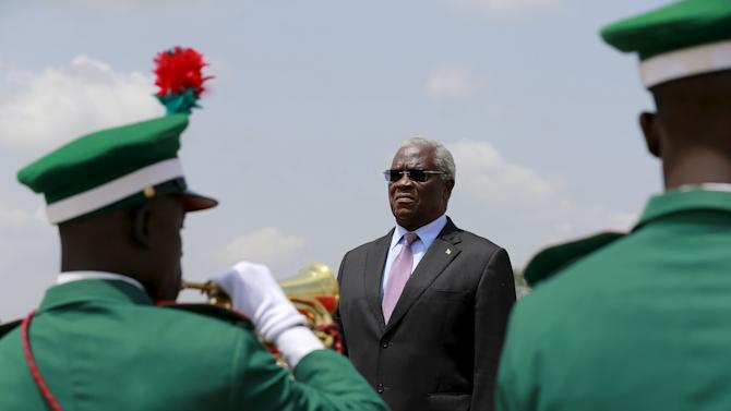Sao Tome and Principe's President Pinto da Costa stands on the podium inspecting the honour guards at the airport in Abuja