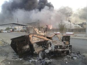 A burnt vehicle is seen during clashes between Iraqi …