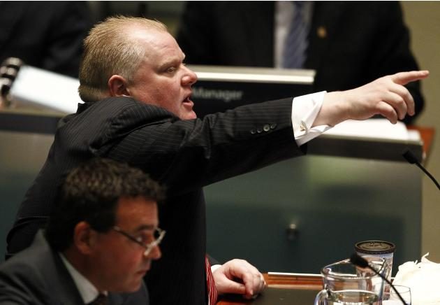 Toronto Mayor Rob Ford reacts during a special council meeting at City
