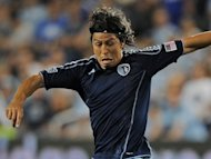 Honduran Olympic Games footballer Roger Espinoza, pictured in May 2012, said he feared his sister may have been caught up in the deadly shooting rampage at a United States cinema