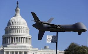 "Demonstrators deploy model of U.S. drone aircraft at ""Stop Watching Us: A Rally Against Mass Surveillance"" near U.S. Capitol in Washington"