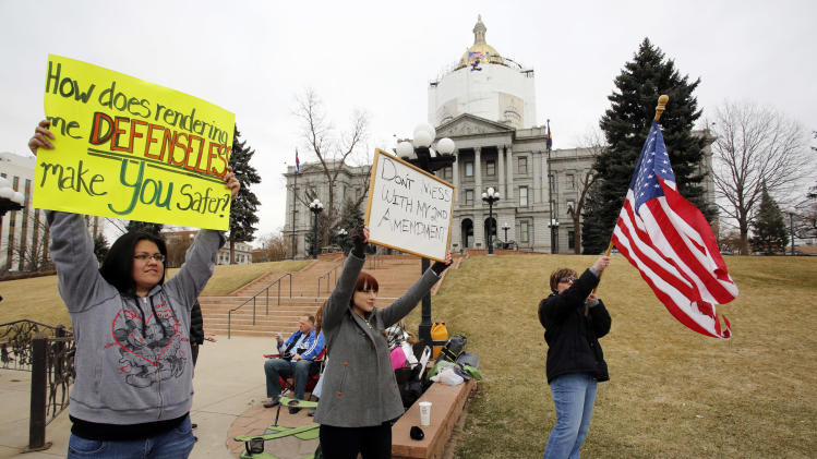 Protesters gather in front of the Capitol in Denver where State Senators are debating seven control bills on Friday, March 8, 2013. Colorado Democrats are on the cusp of passing gun control proposals in a state balancing a history of heartbreaking shootings with a Western heritage where gun ownership is treasured by many.  (AP Photo/Ed Andrieski)