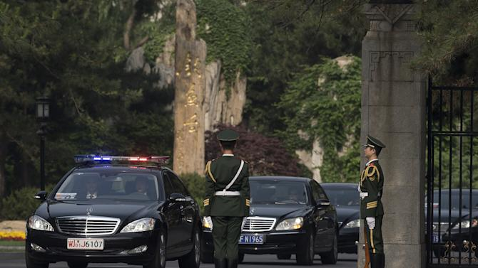 A car, second from left, believed to be carrying North Korean envoy Choe Ryong Hae, is escorted by a convoy of cars as it leaves Beijing's Diaoyutai State Guesthouse Friday, May 24, 2013. Choe is on a fence-mending visit in China as a special envoy for North Korean leader Kim Jong Un. (AP Photo/Andy Wong)