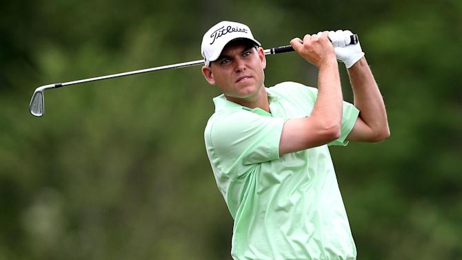 Bill Haas takes a shot on hole fifteen during the third round of the Shell Houston Open golf tournament on Saturday, March, 30, 2013, in Humble, Texas. (AP Photo/ Patric Schneider)