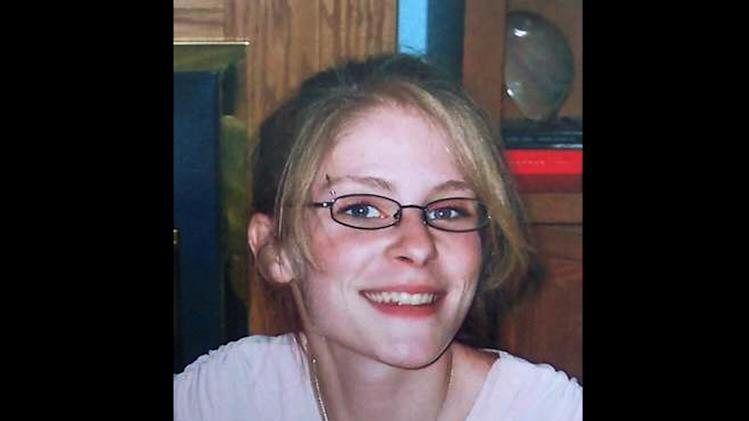 This undated photo provided by the family of Jessica Heeringa via WOOD-TV shows the 25-year-old western Michigan woman, who apparently was abducted Friday, April 26, 2013, from the Exxon Mobil gas station where she worked as a clerk in Norton Shores, Mich. Several friends and acquaintances of Heeringa have been ruled out in her disappearance, which western Michigan investigators are treating as an abduction, the local police chief said Monday, April 29, 2013. (AP Photo/Family photo via WOOD-TV)