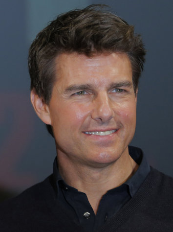 "FILE - In this Jan. 9, 2013 file photo, US actor Tom Cruise poses for photographers during a news conference of his film ""Jack Reacher"" in Tokyo. Cruise is one of several stars whose homes have been targeted by pranksters who place fake 911 calls to try to draw out large police responses in a hoax known as swatting. A hoax call on Jan. 17, 2013 tied up half of Beverly Hills' emergency responders and remains under investigation. (AP Photo/Itsuo Inouye, File)"
