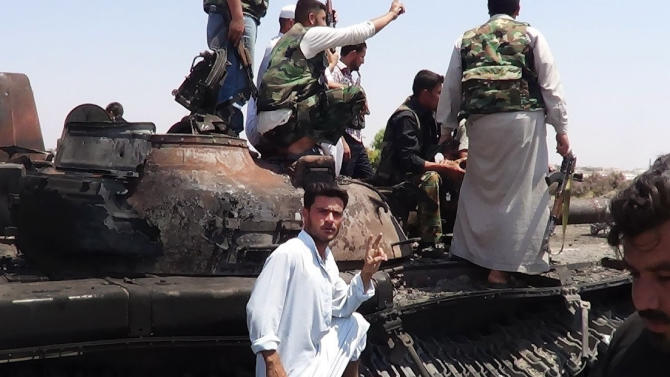 "This citizen journalism image provided by Shaam News Network SNN, taken on Tuesday, July 3, 2012, purports to show Free Syrian Army soldiers sitting on a military tank in Idlib, north Syria. The head of Syria's U.N. observer mission says violence in the country has reached ""unprecedented"" levels and he called for an end to the bloodshed. (AP Photo/Shaam News Network, SNN)THE ASSOCIATED PRESS IS UNABLE TO INDEPENDENTLY VERIFY THE AUTHENTICITY, CONTENT, LOCATION OR DATE OF THIS HANDOUT PHOTO"