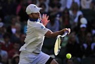 American Andy Roddick plays a forehand shot during his third round men&#39;s singles match against Spain&#39;s David Ferrer at the All England Tennis Club in Wimbledon, southwest London. Roddick slumped to a 2-6, 7-6 (10/8), 6-4, 6-3 defeat