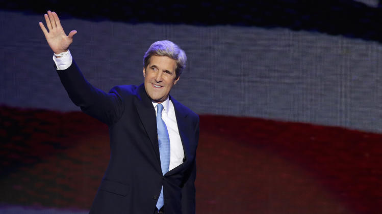 Sen. John Kerry of Massachusetts waves as he walks to the podium to address the Democratic National Convention in Charlotte, N.C., on Thursday, Sept. 6, 2012. (AP Photo/J. Scott Applewhite)