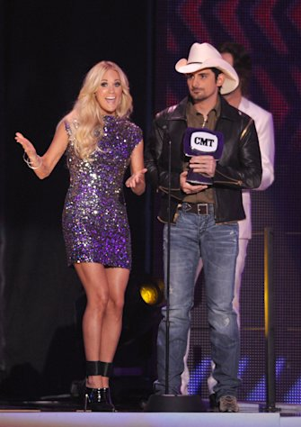 Singer Carrie Underwood, left, and musician Brad Paisley accept the award for Video Of The Year onstage at the 2012 CMT Music Awards on Wednesday, June 6, 2012 in Nashville, Tenn. (Photo by John Shearer/Invision/AP)