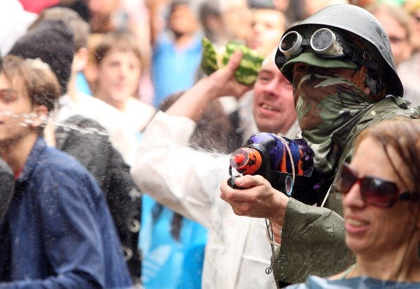 Participants fight in the the annual Vegetable Battle (Gemueseschlacht) on the Oberbaumbruecke on September 2, 2012 in Berlin, Germany. The event pits Kreuzberg district residents againts those of Fri