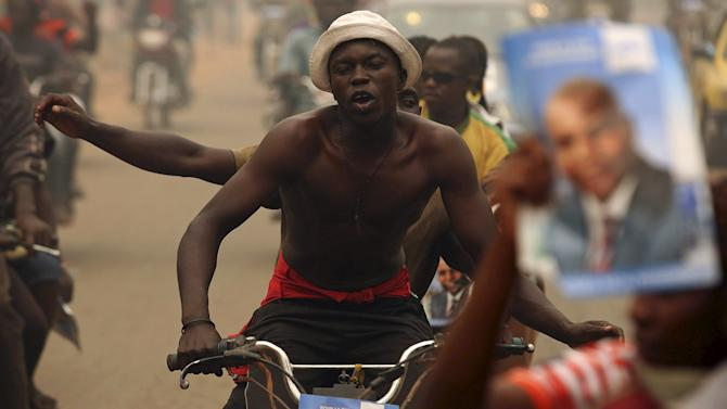 Supporters of presidential candidate Faustin-Archange Touadera react during a campaign ahead of Sunday's second round election against Anicet-Georges Dologuele in Bangui, Central African Republic