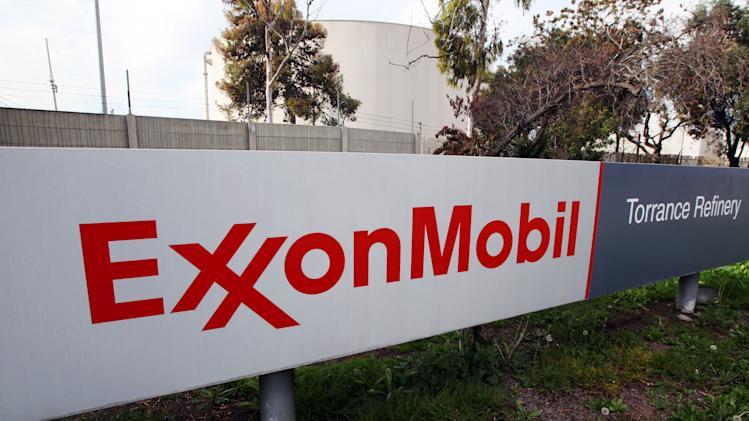 FILE - This Jan. 30, 2012 photo shows the sign for the ExxonMobil Torerance Refinery in Torrance, Calif. Exxon has once again surpassed Apple as the world's most valuable company after the iPhone and iPad maker saw its stock price falter, according to reports Friday, Jan. 25, 2013. Apple first surpassed Exxon in the summer of 2011. The two companies traded places through that fall, until Apple surpassed Exxon for good in early 2012. (AP Photo/Reed Saxon, File)
