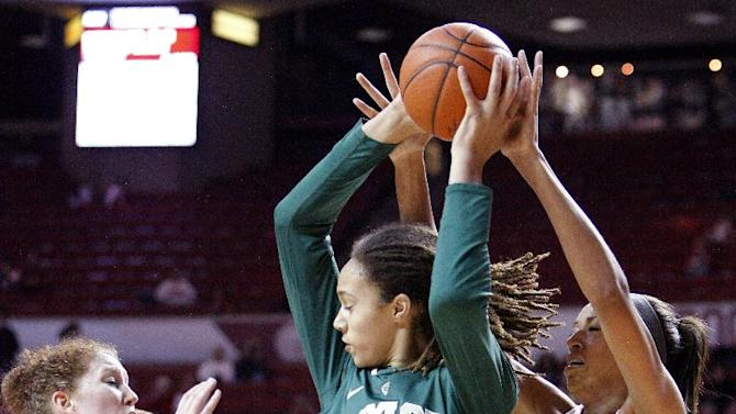 Oklahoma's Joanna McFarland (53) and Nicole Griffin (4) defend as Baylor forward Brittney Griner (42) looks to pass during the first half of a NCAA Women's basketball game in Norman, Monday, Feb. 25, 2013.  (AP Photo/Alonzo Adams)