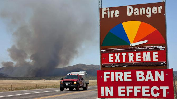 A fire engine moves along Hays Ranch Road as the Yarnell Hill Fire advances on Peeples Valley, Arizona on Sunday, June 30, 2013. (AP Photo/The Arizona Republic, Tom Story)