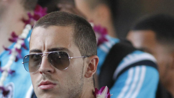 Chelsea's Eden Hazard arrives at Don Muang airport in Bangkok, Thailand Thursday, May 28, 2015. Chelsea is in Bangkok for a friendly match against Thai All-Stars on May 30. (AP Photo/Sakchai Lalit)