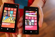 The new Nokia Lumia 920 (L) and 820 Windows smartphones are displayed September 5, in New York City. Microsoft and Nokia joined Wednesday to boost their smartphone arsenal with two new Lumia handsets powered by Windows 8 software