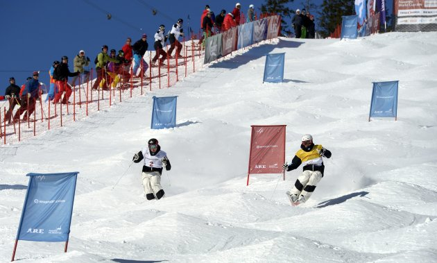 Bilodeau of Canada and compatriot Kingsbury compete during the FIS Freestyle Skiing World Cup Moguls in Are