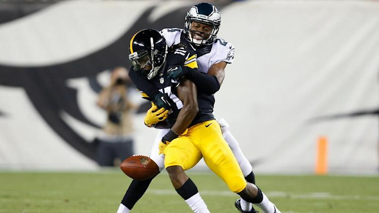 Pittsburgh Steelers' Markus Wheaton (11) cannot catch a pass as Philadelphia Eagles' Bradley Fletcher (24) hangs on during the first half of an NFL preseason football game, Thursday, Aug. 21, 2014, in Philadelphia