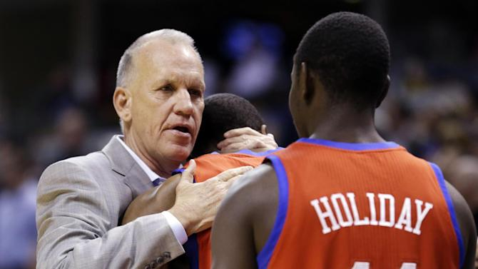 Philadelphia 76ers head coach Doug Collins, left, hugs forward Thaddeus Young as guard Jrue Holiday looks on before their NBA basketball game against the Indiana Pacers in Indianapolis, Wednesday, April 17, 2013. (AP Photo/Michael Conroy)