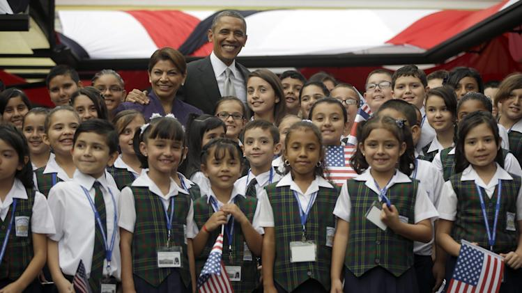 President Barack Obama and Costa Rica President Laura Chinchilla pose for a group photo with young children who performed at a cultural event at the Casa Amarilla in San Jose, Costa Rica, Friday, May 3, 2013. (AP Photo/Pablo Martinez Monsivais)