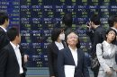 World stocks volatile amid growth uncertainty