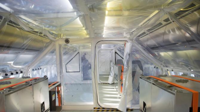 Protective plastic sheeting surrounds the isolation unit inside new Medevac plane in Berlin