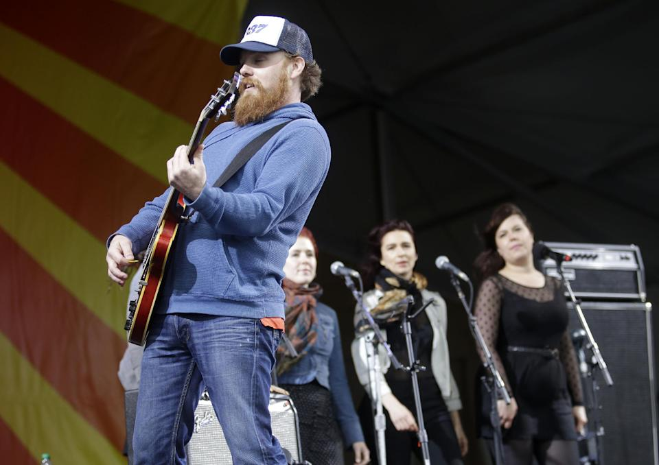 Marc Broussard performs at the New Orleans Jazz and Heritage Festival in New Orleans, Friday, May 3, 2013. (AP Photo/Gerald Herbert)