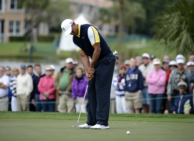 Tiger Woods of the U.S. putts at the 8th hole during second round play in the Honda Classic PGA golf tournament in Palm Beach Gardens