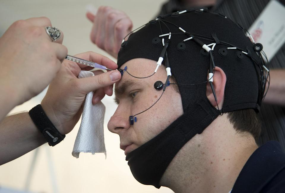 Russ Martin of American Automobile Association (AAA), is hooked to an electroencephalographic (EEG)-configured skull cap, during a demonstrations in support of their new study on distracted driving in Landover, Md., Tuesday, June 11, 2013. (AP Photo/Manuel Balce Ceneta)