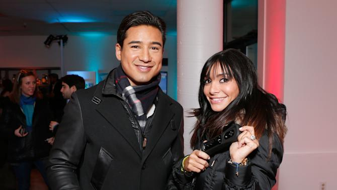 IMAGE DISTRIBUTED FOR NINTENDO - Mario Lopez, left, and Courtney Laine Mazza warm up and check out Wii U at the Nintendo Lounge while playing Super Mario Bros. U during a break from the Sundance Film Festival on Friday, January 18, 2013 in Park City, UT. (Photo by Todd Williamson/Invision for Nintendo/AP Images)