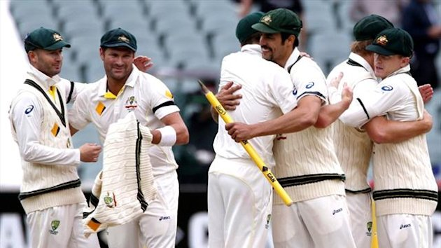 Australia players celebrate victory over England at Adelaide (Reuters)
