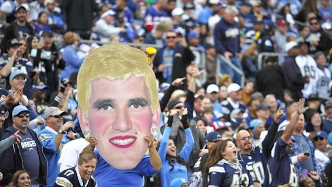 San Diego Chargers fans hold an altered image of New York Giants quarterback Eli Manning during an NFL football game on Sunday, Dec. 8, 2013, in San Diego