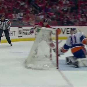 Kuznetsov bats puck out of midair past Halak