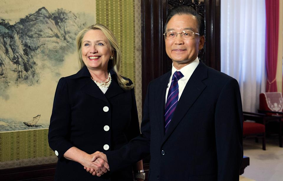 U.S. Secretary of State Hillary Rodham Clinton, left, shakes hands with Chinese Premier Wen Jiabao during a bilateral meeting at the Zhongnanhai leadership compound in Beijing, China, on Wednesday, Sept. 5, 2012.  (AP Photo/Jim Watson, Pool)